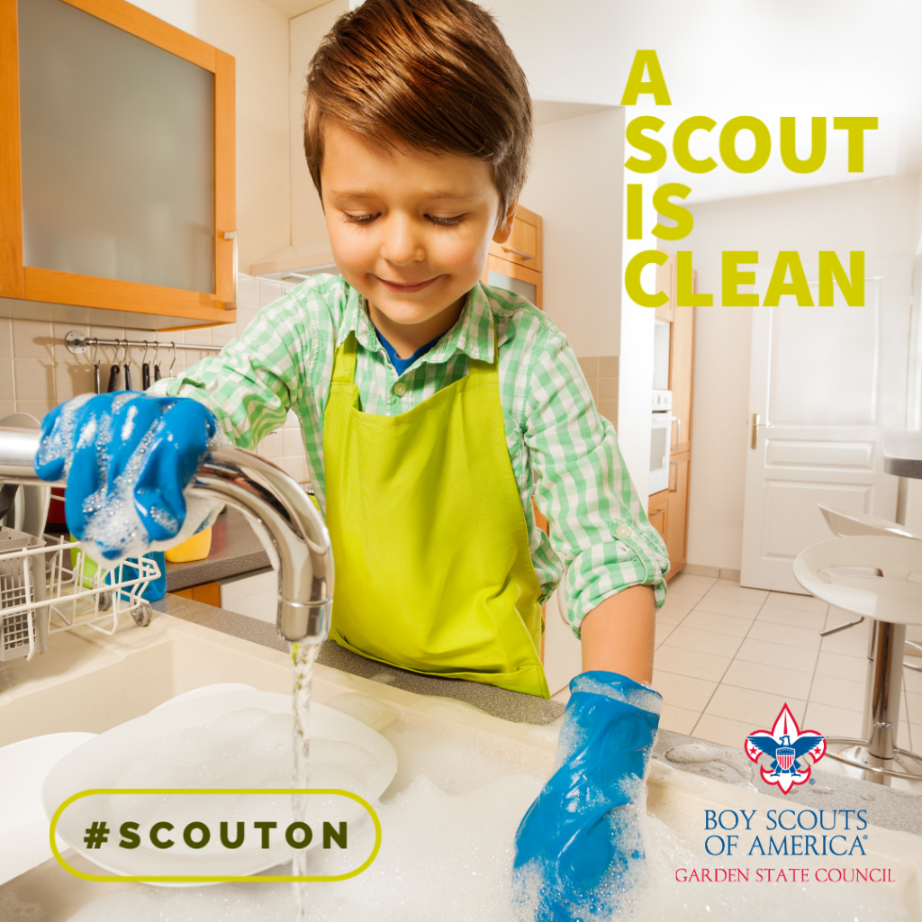 A Cub Scout is helping clean the dishes because Cubs do their best
