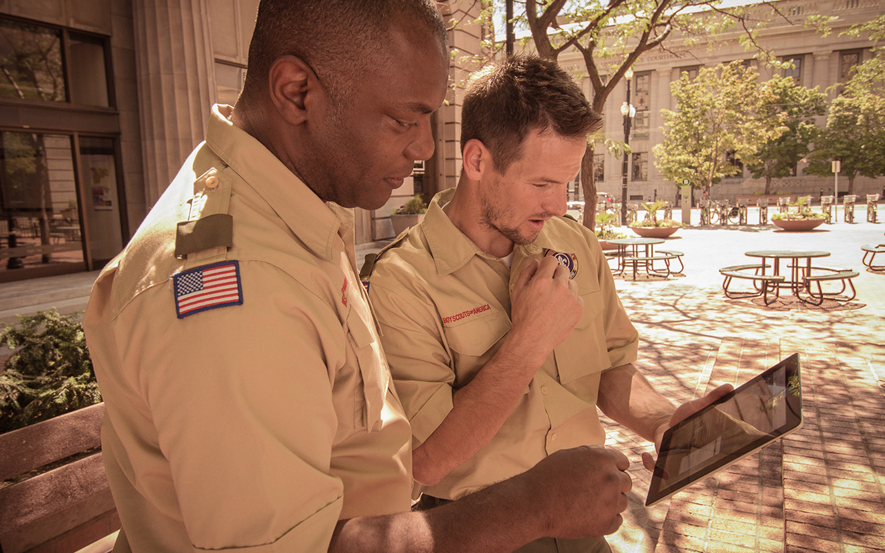 Scoutmasters collaborating in uniform